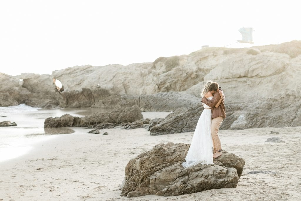 Big hugs on elopement day in Malibu, CA