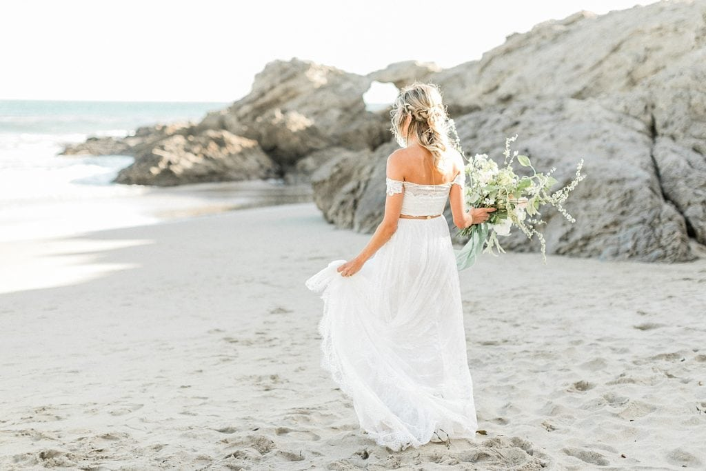 Bride walking on Malibu beach
