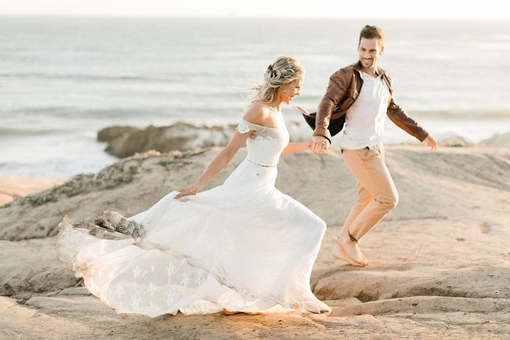 Couple running after elopement ceremony