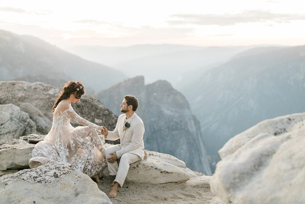 What is an elopement? | What does it mean to elope in 2020? | couple reading vows in Yosemite National Park
